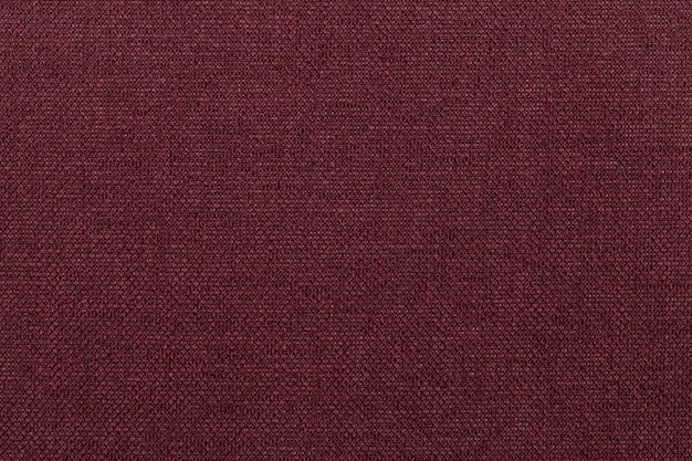 Sfondo rosso scuro da materiale tessile.