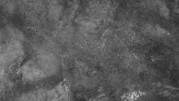 Sfondo ruvido grunge. pietra nera sbucciata arrugginita. struttura astratta della parete del frammento. superficie del cemento grigio.