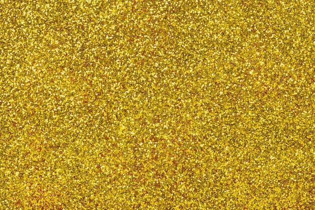 Sfondo scintillante dorato da piccoli paillettes