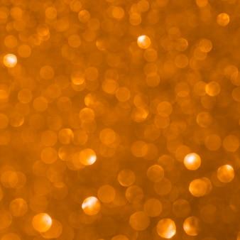 Sfondo sfocato glitter arancione