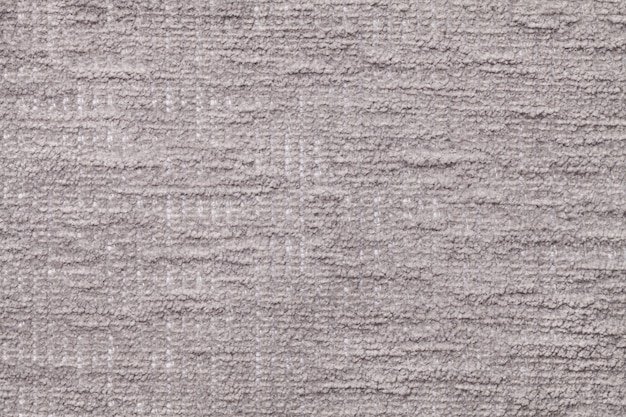 Sfondo soffice grigio chiaro di stoffa morbida e soffice.
