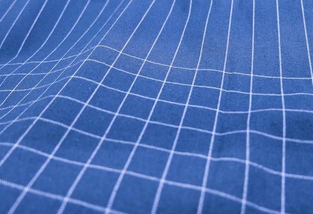 Sfondo tessuto plaid blu e bianco