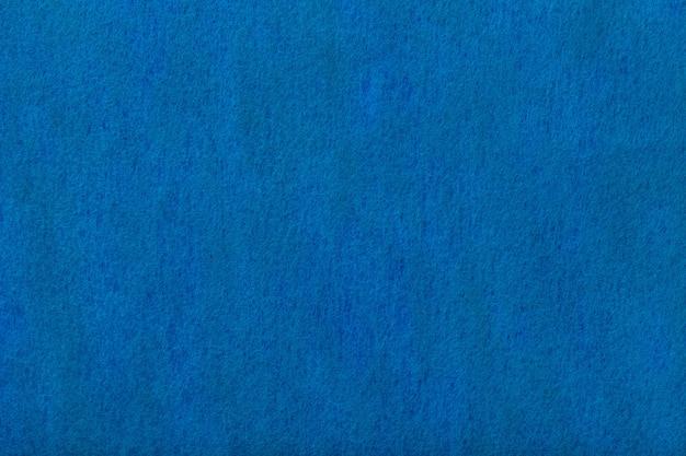 Sfondo tessuto scamosciato opaco blu navy. texture vellutata di feltro.