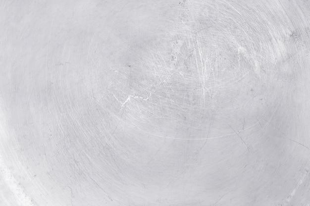 Sfondo texture metallo alluminio, graffi su acciaio inossidabile lucido.