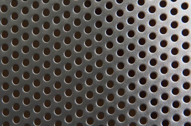 Sfondo texture metallo con fori rotondi. superficie macro