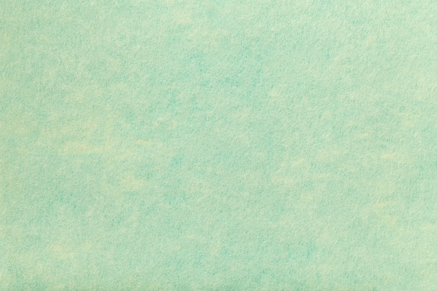 Sfondo turchese chiaro di tessuto feltro.