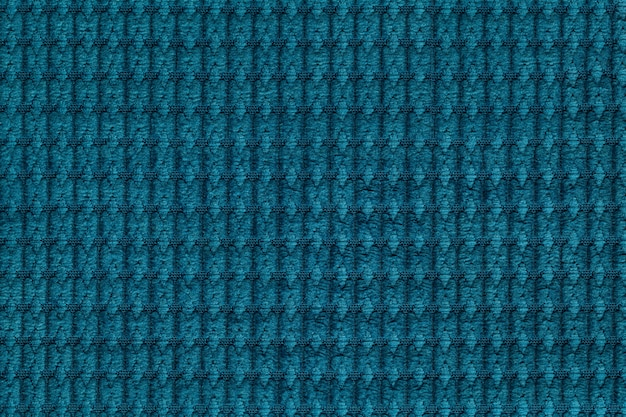 Sfondo turchese scuro dalla fine morbida del tessuto fleecy in su.