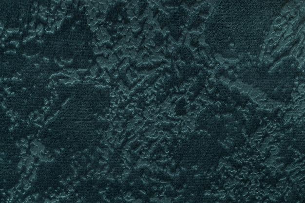Sfondo verde scuro da un materiale tessile morbido rivestimento, primo piano.