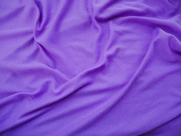 Sfondo viola trama del tessuto di seta, abbigliamento sportivo