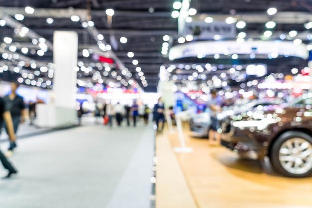 Sfuocatura astratta ed esposizione di manifestazione di mostra dell'automobile e dell'automobile defocused