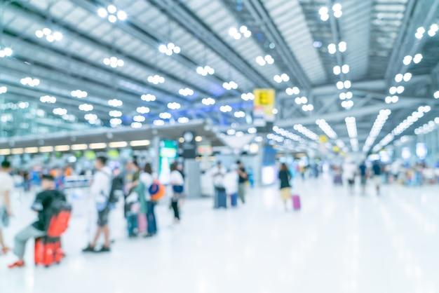 Sfuocatura astratta ed interno defocused del terminale di aeroporto