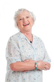 Signora senior gioiosa felice e sorridere isolato su bianco
