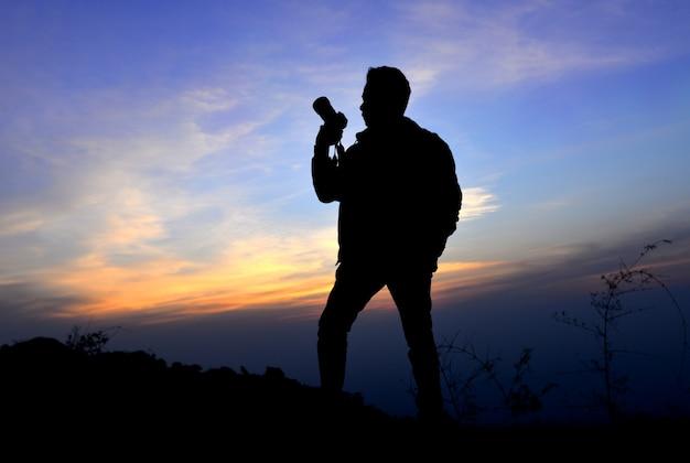 Silhouette di azione fotografo libertà