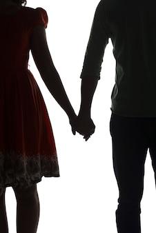Silhouette di coppia tenendo la mano