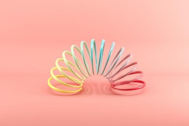Slinky colorato isolato su rosa