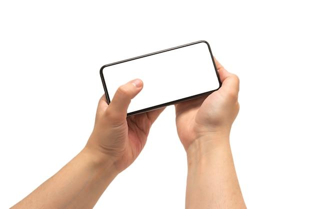 Smart phone in mano d'uomo isolato