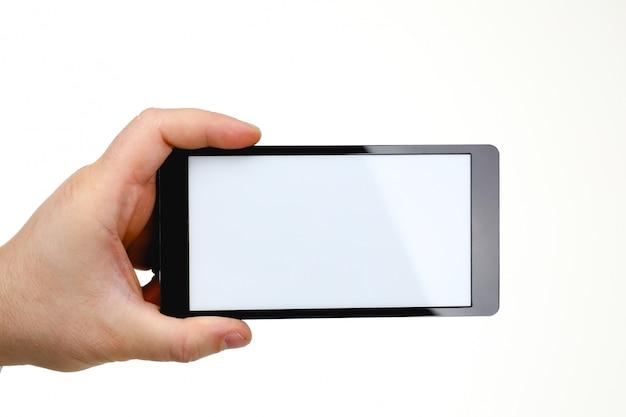 Smartphone hoding della mano maschio isolato