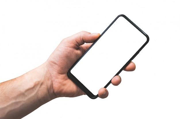 Smartphone isolato in mano uomo - primo piano, su uno sfondo bianco.