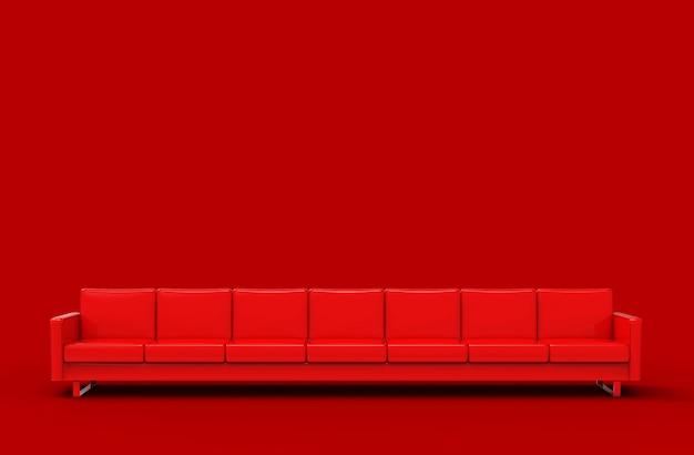Sofà rosso estremamente lungo isolato su rosso