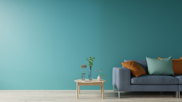 Soggiorno blu con divano e tavolo.