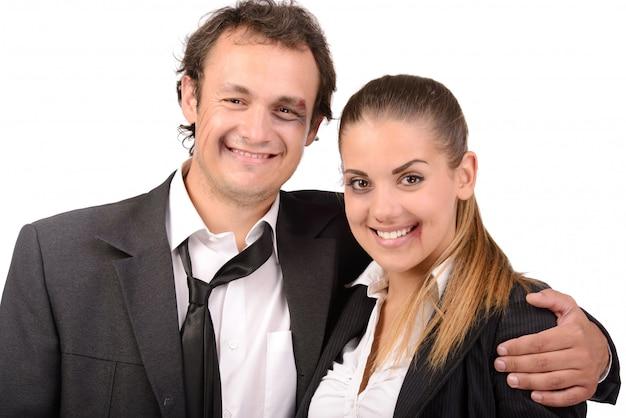Sorriso dell'uomo d'affari e della donna di affari di lotta.