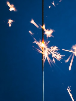 Sparkler stick on blue