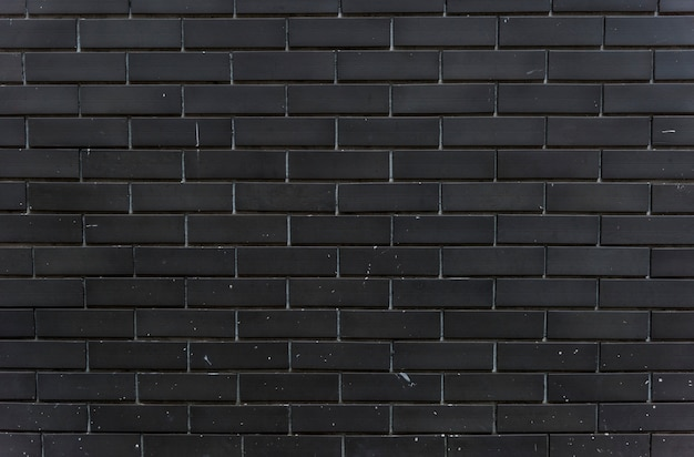 Spazio di design di muro di mattoni neri