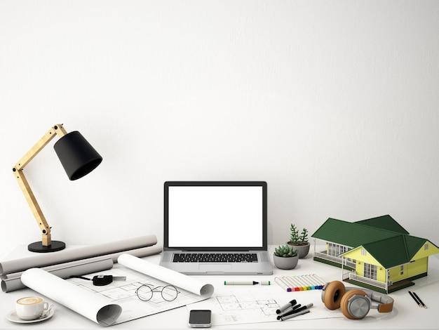 Spazio di lavoro con laptop schermo sul tavolo bianco e muro bianco