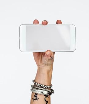 Spazio in bianco della copia del telefono cellulare della tenuta della mano