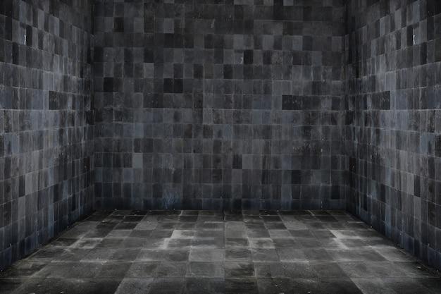 Spazio vuoto della stanza per lo sfondo con muro scuro