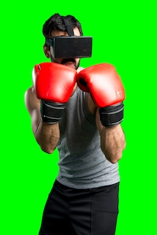 Sportman con guanti di pugilato e vetri vr