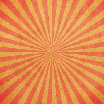 Sprazzo di sole rosso e giallo vintage e pattern di sfondo con lo spazio.