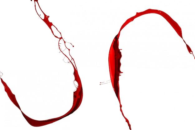 Spruzzata di vernice rossa isolato su sfondo bianco.