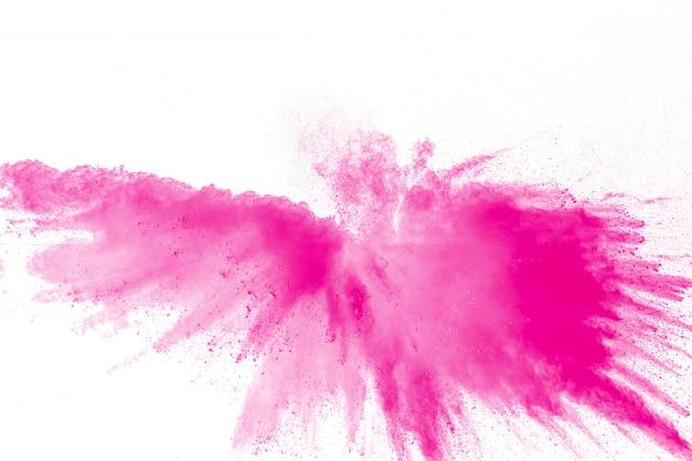 Spruzzi di particelle di polvere rosa. esplosione di polvere rosa