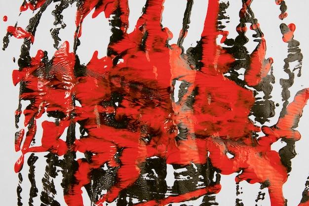 Spruzzi di vernice rossa e nera