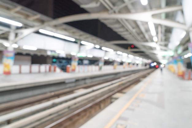 Stazione ferroviaria elettrica di sfocatura astratta
