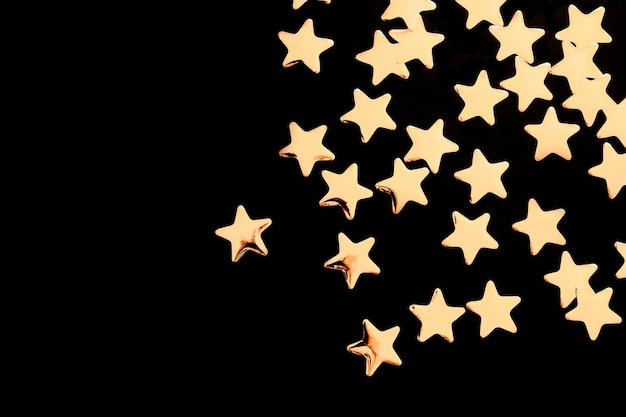 Stelle decorative dorate su fondo nero