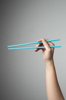 Stile cinese giapponese asiatico dell'alimento della bacchetta della mano tradizionale