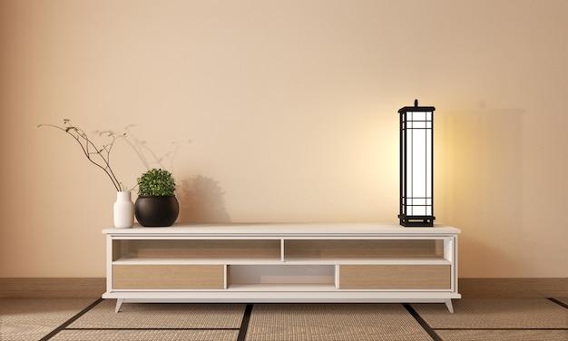 Stile giapponese del gabinetto tv di legno su stile di zen della stanza e stuoia di tatami, rappresentazione 3d