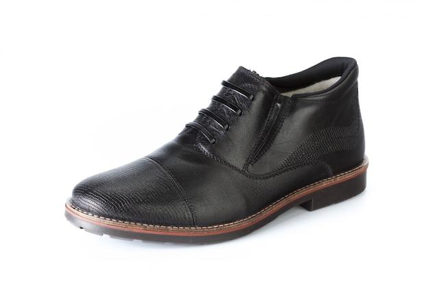 Stivaletti maschii delle scarpe isolati su bianco