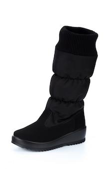 Stivali di cuoio del ginocchio alto della donna isolati su bianco