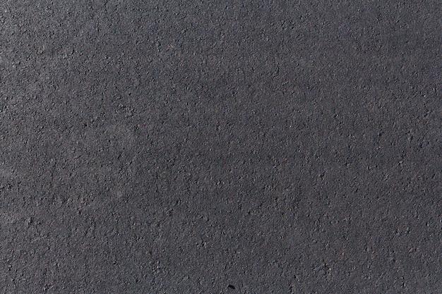 Strada asfaltata nera, primo piano di struttura della priorità bassa
