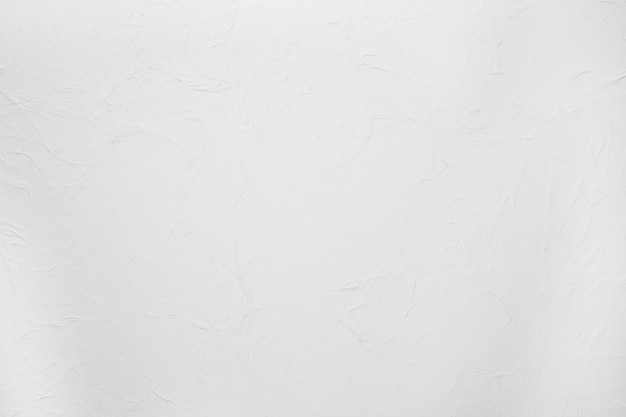 Struttura approssimativa del muro di cemento intonacato bianco
