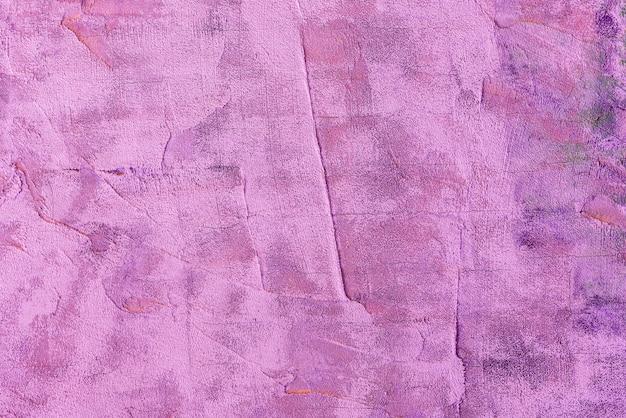 Struttura astratta del fondo del muro di cemento ruvido di colore porpora luminoso. contesto retrò e vintage.