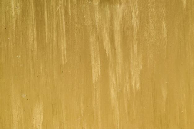 Struttura astratta del muro di cemento dell'oro. dorato sul fondo del muro di cemento