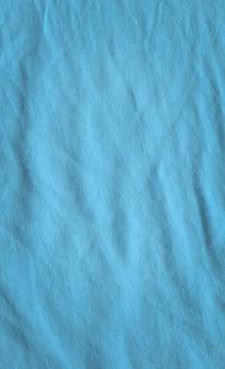 Struttura astratta del tessuto blu. trama di lino naturale blu
