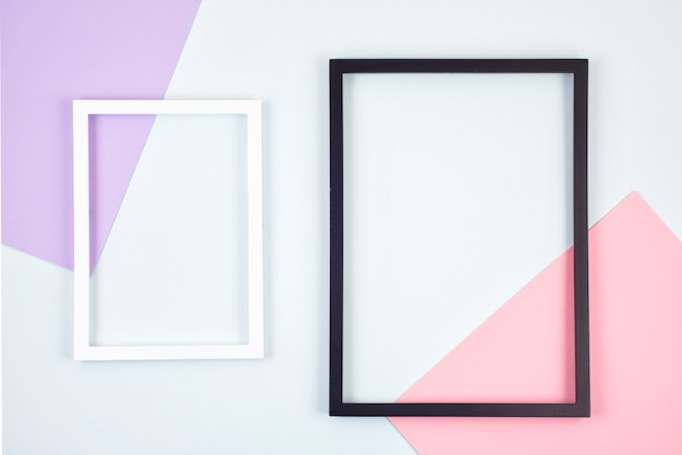 Struttura astratta della carta colorata pastello con cornici vuote