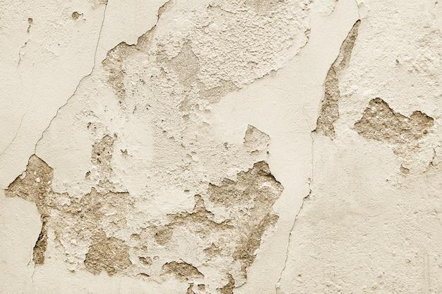 Struttura beige del fondo del muro di cemento