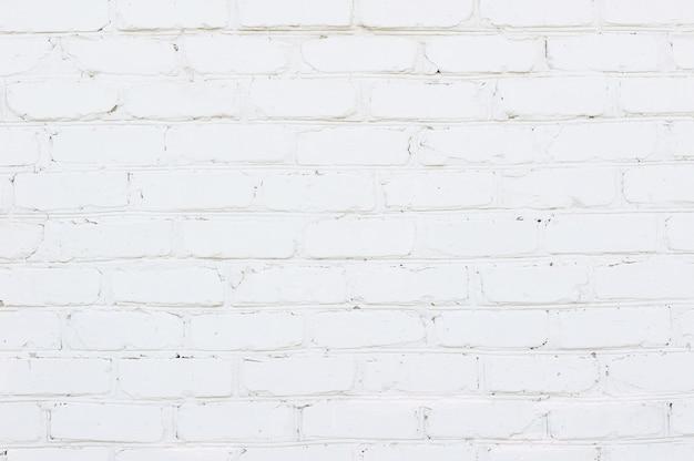Struttura bianca astratta del fondo del muro di mattoni di lerciume