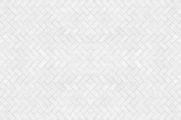 Struttura bianca stagionata astratta del muro di mattoni.